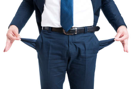 Poor businessman showing empty pants pockets isolated on white background