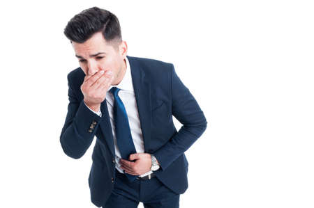 throw up: Businessman feeling sick from indigestion or food poisoning covering his mouth to throw up