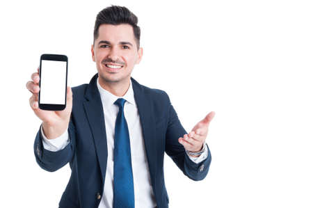 Business, success and technology concept with businessman showing smartphone with blank screen and copy space isolated on white