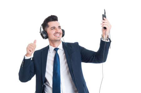 telephone salesman: Smiling young businessman taking a selfie while listening music and thumb up isolated on white