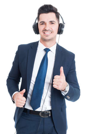 thumbup: Smiling attractive lawyer doing thumbup gesture and listening music on headphones isolated on white Stock Photo