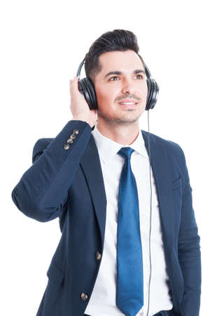 banker: Relaxed smiling businessman or banker resting and enjoying music on headphones isolated on white background