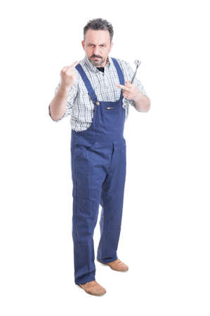 obscene: Full body of repairman or mechanic showing both middle fingers as obscene gesture concept isolated on white