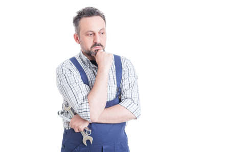 blue overall: Thoughtful man portrait with young mechanic in blue overall looking worried with copyspace isolated on white