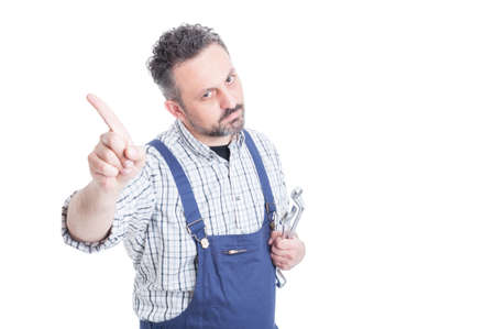 refusal: Portrait of serious mechanic doing no or refusal gesture with copyspace isolated on white
