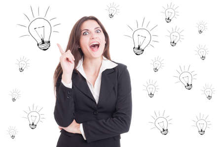 revelation: Attractive cheerful business woman having a revelation and pointing up as idea concept with lightbulb marks on white background
