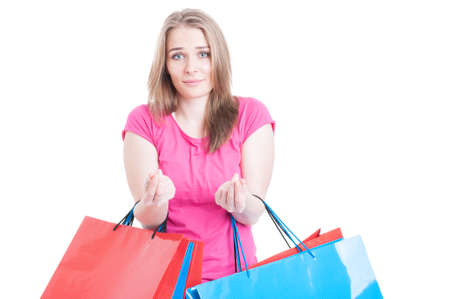 overspending: Beautiful woman having no money after a day of shopping looking unhappy as overspending concept isolated on white
