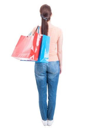 shoulder carrying: Backview and full body of woman standing and carrying shopping bags on shoulder looking up isolated on white background