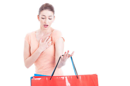 indignant: Woman carrying few shopping bags feeling shocked or indignant isolated on white background with copy text space