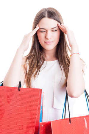long day: Young shopaholic having a headache and looking tired after a long day of shopping isolated on white