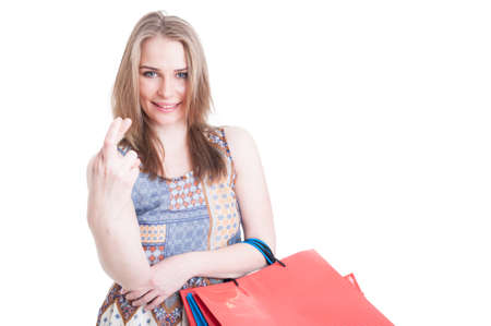 finger crossed: Good luck concept with young shopaholic holding finger crossed and smiling isolated on white with copyspace