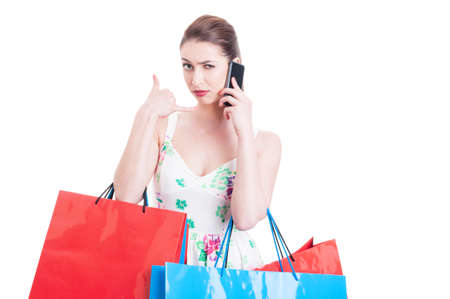 eyebrow raised: Woman shopper looking mad and making call me gesture as having a problem isolated on white background with advertising area Stock Photo