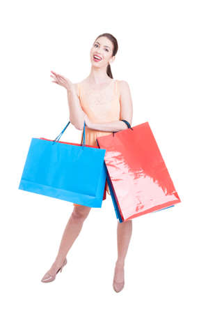 spending full: Lady shopper posing happy and content with gift bags isolated on white background