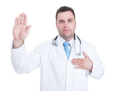 hippocratic: Male young doctor or medic swearing or having the Hippocratic oath isolated on white background with advertising area