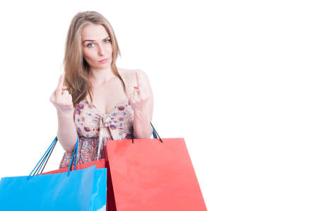obscene: Rude young shopping female showing both middle fingers as insulting or obscene gesture concept isolated on white background with copyspace