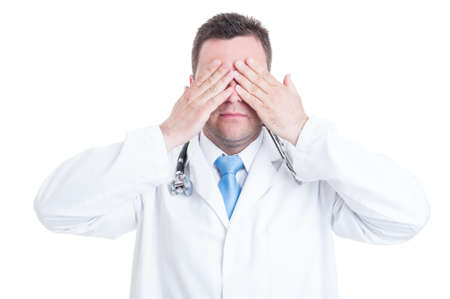Concept of male medic or doctor making blind gesture by covering his eyes isolated on white background with copy text space