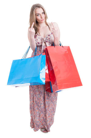 obscene: Bad shopper female with gift bags doing double obscene gesture by showing both middle fingers isolated on white with copyspace Stock Photo