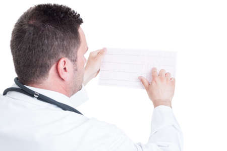the cardiologist: Male medic cardiologist reading ekg cardiogram paper isolated on white background