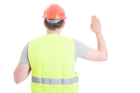 pledge: Back view of male constructor standing and doing a vow as pledge concept isolated on white background