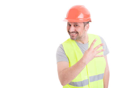 Cheerful handsome constructor holding four fingers up and smiling isolated on white background with copy space