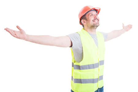 arms wide open: Happy smiling builder or constructor enjoying victory and standing with arms wide open isolated on white studio background Stock Photo