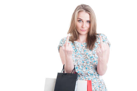 offensive: Naughty female shopper showing both middle fingers while doing shopping as offensive gesture concept isolated on white background Stock Photo