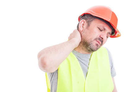 Portrait of tensed young constructor feeling exhausted as stressful work concept isolated on white studio background Standard-Bild