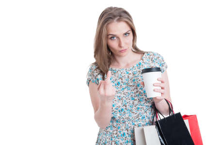 obscene: Rebel shopper doing obscene gesture with middle finger and drinking fresh coffee isolated on white with copy space