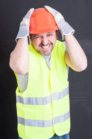 forgot: Funny male constructor forgot to do or remember something isolated on black background