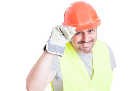 salutation: Portrait of cheerful constructor doing a salutation gesture looking friendly isolated on white background