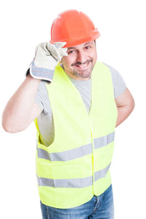polite: Attractive builder man smiling and holding helmet acting polite isolated on white studio background