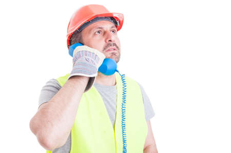 work gloves: Serious constructor calling someone to urgent solve work problem isolated on white studio background
