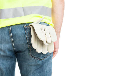 vest in isolated: Builder with gloves in back pocket wearing safety vest isolated on white with advertising area