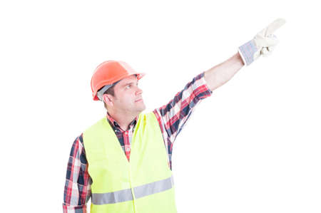 Professional male constructor poiting finger up acting like superhero isolated on white background Stock Photo