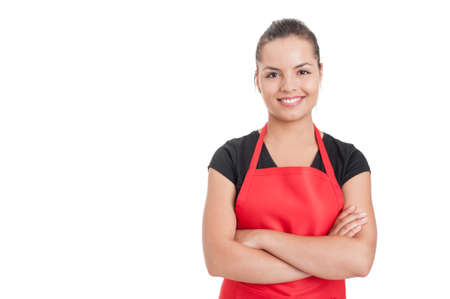 Confident cute employee on supermarket standing with folded arms and smiling isolated on white with copyspace