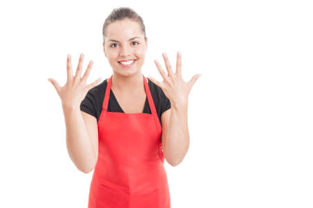 numero diez: Beautiful female employee showing number ten with both hands isolated on white with copy space area