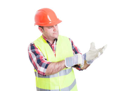 reflective: Attractive constructor adjusting his gloves and getting ready for work isolated on white background