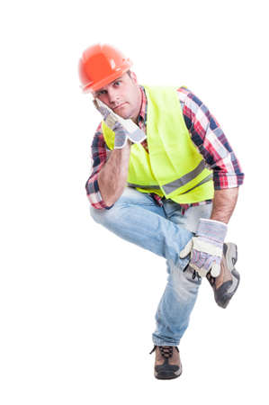 dissapointed: Thoughtful constructor sitting on something and looking dissapointed as work problem concept isolated on white background Stock Photo