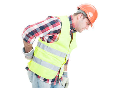 Young constructor suffering form back pain and bending over isolated on white background