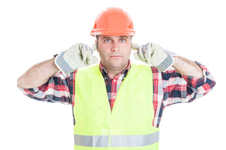 Hear no evil concept with attractive male builder refusing to listen isolated on white background Stock Photo