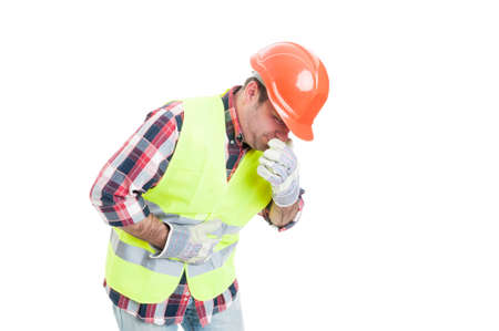 Builder with stomach problem is about to vomit as nausea and sickness concept isolated on white background