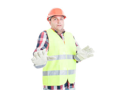 Young constructor looking terrified or scared  of something isolated on white background
