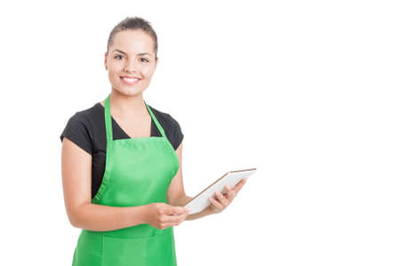 sales promotion: Successful hypermarket employee with green apron holding modern tablet isolated on white background with copyspace