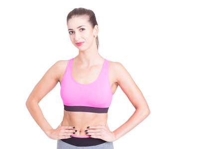 Beautiful fit trainer posing in sporty wear isolated on white with copy text space Stock Photo
