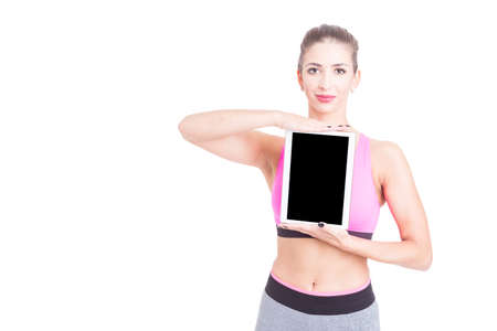 Female holding tablet wearing pink bustier and thighs isolated on white with copy text space