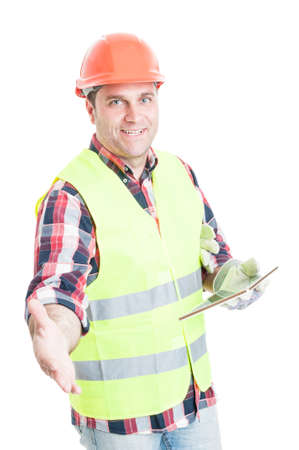 Handsome constructor with tablet doing a handshake gesture as welcoming concept isolated on white background