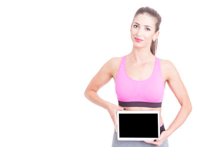 Fit young girl wearing sport wear holding tablet isolated on white with copy text space