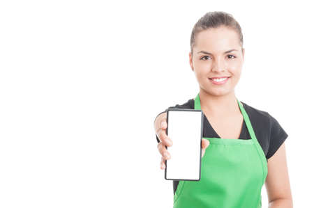 Joyful hypermarket employee holding smartphone with blank screen and copyspace area isolated on white background