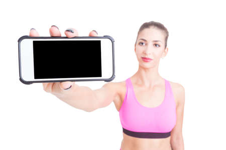 Selective focus of woman sport trainer holding telephone isolated on white background with copy text space Stock Photo