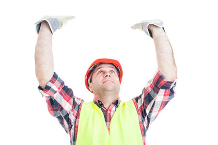 Construction worker rising up or pushing somehting heavy isolated on white background Stock Photo